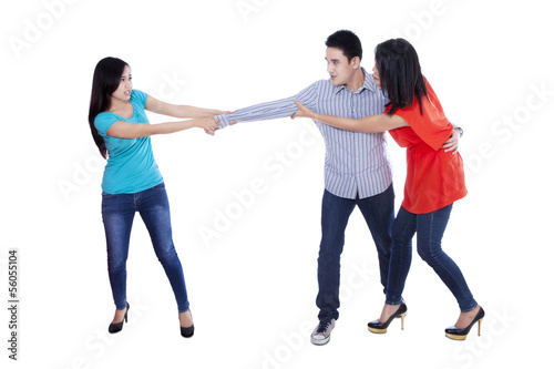 Two beautiful woman fighting over man