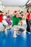 Fitness - Zumba training and workout in gym