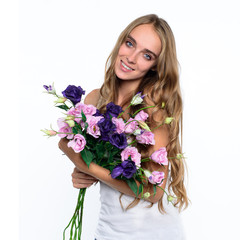 Beautiful happy woman holding bouquet of flowers