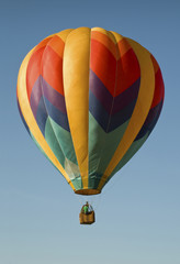 Hot-air balloon floating in a blue sky
