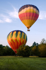 Two hot-air balloons taking off or landing