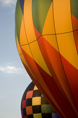 Close-up of the envelopes of two hot-air balloons
