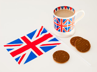 a cup of English tea and chocolate biscuits with a flag