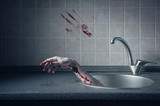 Bloody hand in kitchen sink