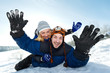 young happy couple sledding in winter