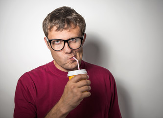 Man drinking from a disposable paper cup with a straw