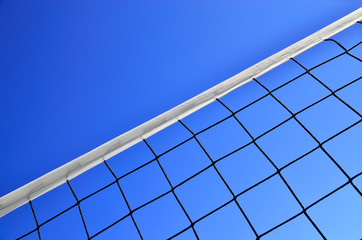 Volleyball net on the background of blue sky