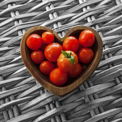 Tomatos in Wooden Heart Shaped Bowl