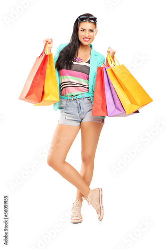 Attractive casual female posing with shopping bags