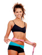 Slim brunette girl with tape measure and fitness clothes