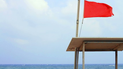 The warning flag on the tower at the sea rescue