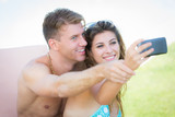 Young Couple on Vacation using Taking Self Portrait