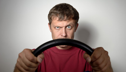 Portrait of a man with a steering wheel