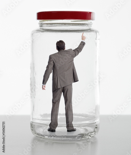 Business woman in jar.
