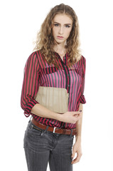 young woman posing with purse isolated on white background
