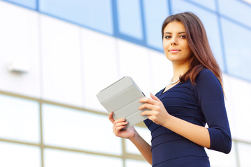Smiling businesswoman using electronic tablet