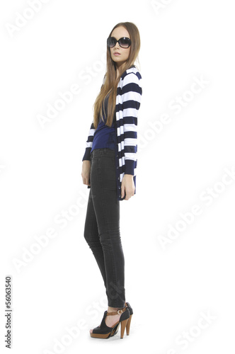 Full body young woman in stripy shirt with sunglasses posing
