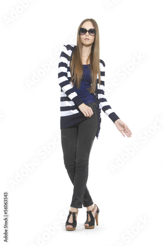 young woman in stripy shirt with sunglasses posing at studio