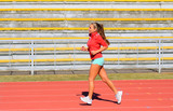 Sports woman running on tracks