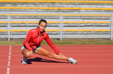 Attractive woman doing stretching exercises before run