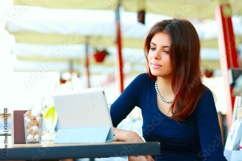 Elegant beautiful woman with tablet computer