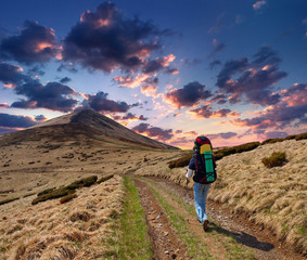 sportive man on the mountain trek