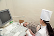 doctor making ultrasound investigation in medical clinic