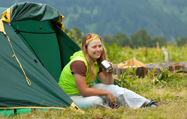 Happy  tourist   in front camp tent