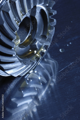 gears, oil and lubricant mirrored in titanium