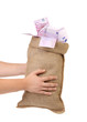 Man hands holding money bag full with euro bills