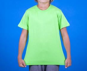green T-shirt on a cute boy