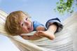 Leinwanddruck Bild - Lachendes Kind in Hängematte