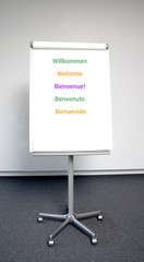 Willkommen in fünf Sprachen auf Flipchart