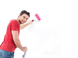 Man in casual with roller and painting wall