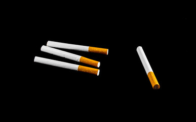four cigarette isolated on black background