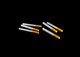 many cigarette isolated on black background