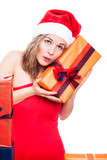 Curious Christmas woman with present
