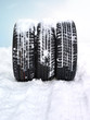 Three winter tyres in the snow