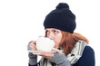 Woman drinking hot tea or coffee