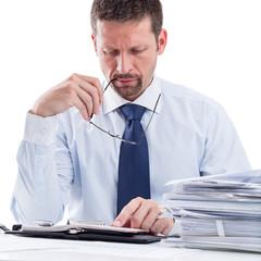 Portrait of thoughtful businessman planning work.