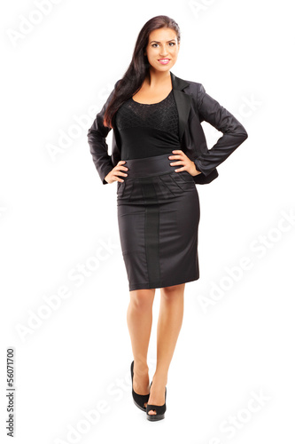 Full length portrait of a smiling beautiful woman in suit posing