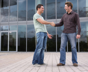 Two men meeting outdoors