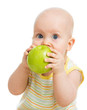 Baby boy eating green apple, isolated on white