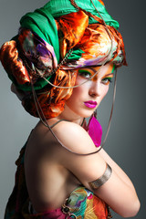 photo of redheaded girl in a head-dress from the coloured fabric