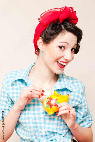 Retro pinup woman put money dollar note to porcelain mouse bank