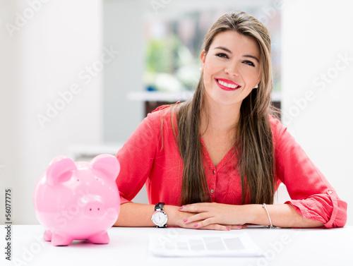 Woman saving in a piggybank