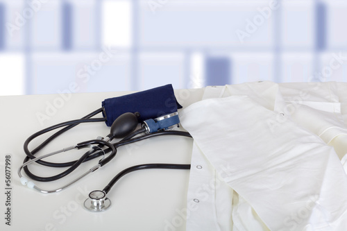 Doctor's coat and stethoscope on the table