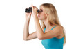 Side view of blond woman looking through binoculars