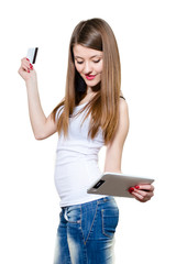 Young happy woman holding credit card and tablet pc