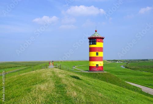 Leinwanddruck Bild Leuchtturm an der Küste